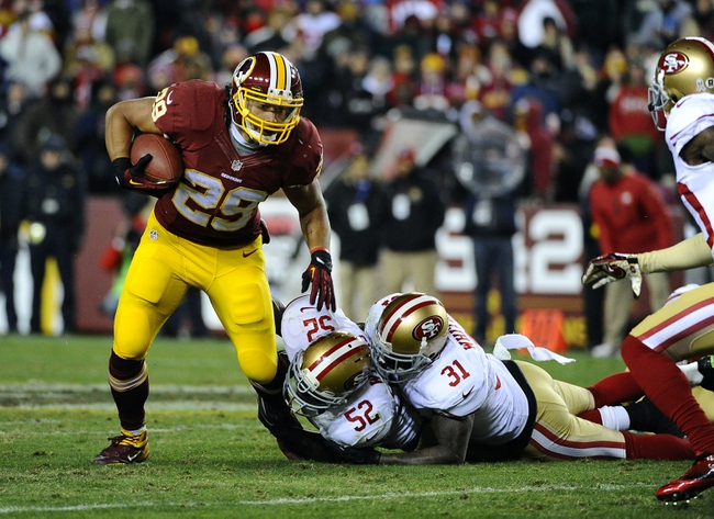 Nov 25, 2013; Landover, MD, USA; Washington Redskins running back Roy Helu (29) is tackled by San Francisco 49ers linebacker Patrick Willis (52) and safety Donte Whitner (31) during the second half at FedEx Field. The 49ers won 27-6. Mandatory Credit: Brad Mills-USA TODAY Sports