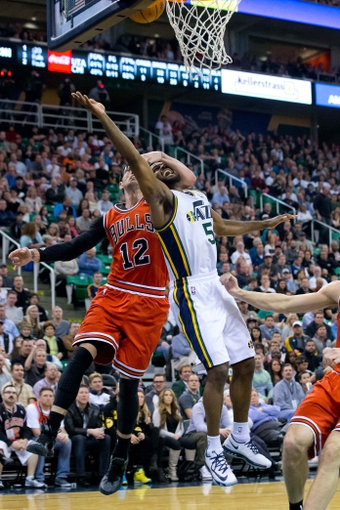 iNov 25, 2013; Salt Lake City, UT, USA; Chicago Bulls shooting guard Kirk Hinrich (12) commits a flagrant foul on Utah Jazz point guard John Lucas III (5) during the second half at EnergySolutions Arena. The Jazz won 89-83 in overtime. Mandatory Credit: Russ Isabella-USA TODAY Sports