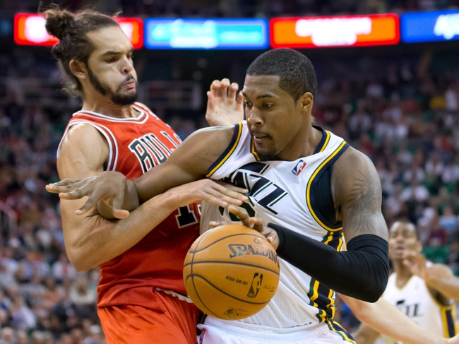 Nov 25, 2013; Salt Lake City, UT, USA; Utah Jazz power forward Derrick Favors (15) is defended by Chicago Bulls center Joakim Noah (13) during the second half at EnergySolutions Arena. The Jazz won 89-83 in overtime. Mandatory Credit: Russ Isabella-USA TODAY Sports