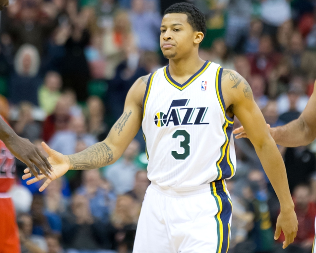 Nov 25, 2013; Salt Lake City, UT, USA; Utah Jazz point guard Trey Burke (3) reacts during overtime against the Chicago Bulls at EnergySolutions Arena. The Jazz won 89-83 in overtime. Mandatory Credit: Russ Isabella-USA TODAY Sports