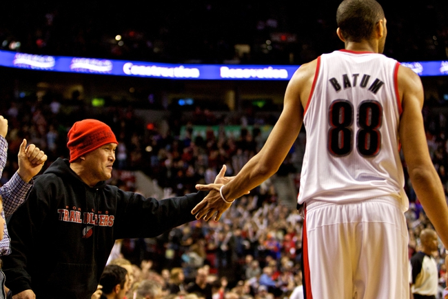 Nov 25, 2013; Portland, OR, USA; Portland Trail Blazers small forward Nicolas Batum (88) high fives a fan at the end of the game against the New York Knicks at the Moda Center. Mandatory Credit: Craig Mitchelldyer-USA TODAY Sports