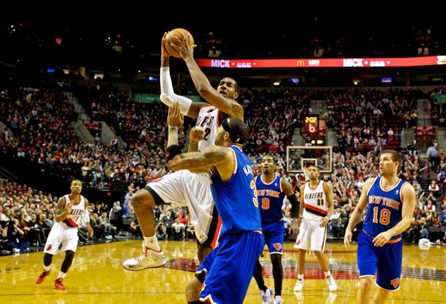 Nov 25, 2013; Portland, OR, USA; Portland Trail Blazers power forward LaMarcus Aldridge (12) shoots over New York Knicks power forward Kenyon Martin (3) at the Moda Center. Mandatory Credit: Craig Mitchelldyer-USA TODAY Sports