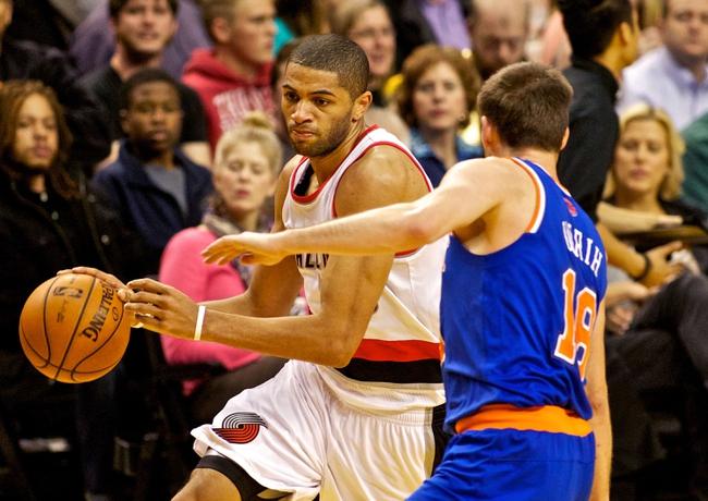 Nov 25, 2013; Portland, OR, USA; Portland Trail Blazers small forward Nicolas Batum (88) drives to the basket against the New York Knicks at the Moda Center. Mandatory Credit: Craig Mitchelldyer-USA TODAY Sports