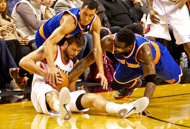 Nov 25, 2013; Portland, OR, USA; New York Knicks power forward Amar'e Stoudemire (1) and point guard Pablo Prigioni (9) fight for a loose ball with Portland Trail Blazers center Joel Freeland (19) at the Moda Center. Mandatory Credit: Craig Mitchelldyer-USA TODAY Sports