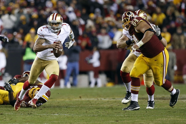 Nov 25, 2013; Landover, MD, USA; San Francisco 49ers quarterback Colin Kaepernick (7) runs with the ball past Washington Redskins defensive end Kedric Golston (64) in the fourth quarter at FedEx Field. The 49ers won 27-6. Mandatory Credit: Geoff Burke-USA TODAY Sports
