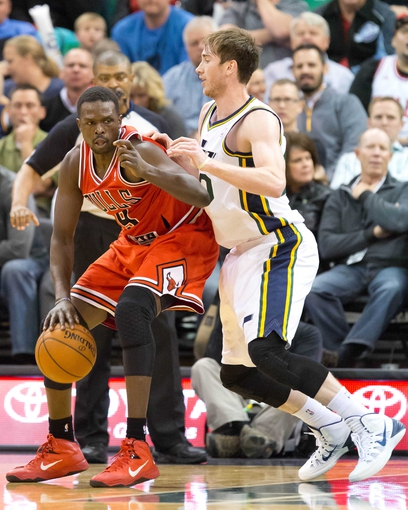 Nov 25, 2013; Salt Lake City, UT, USA; Chicago Bulls small forward Luol Deng (9) is defended by Utah Jazz shooting guard Gordon Hayward (20) during the second half at EnergySolutions Arena. The Jazz won 89-83 in overtime. Mandatory Credit: Russ Isabella-USA TODAY Sports