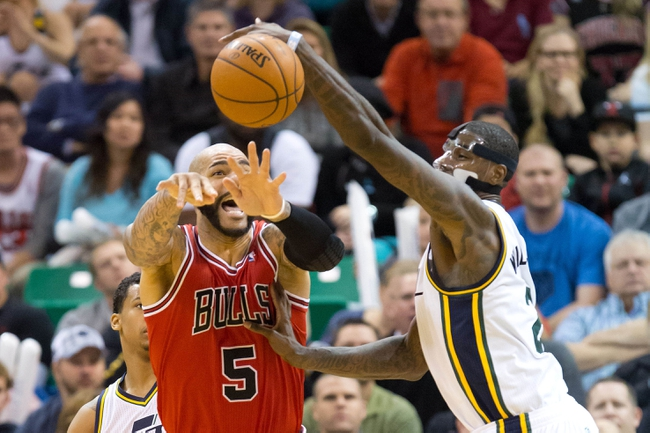 Nov 25, 2013; Salt Lake City, UT, USA; Utah Jazz power forward Marvin Williams (2) steals the ball from Chicago Bulls power forward Carlos Boozer (5) during the second half at EnergySolutions Arena. The Jazz won 89-83 in overtime. Mandatory Credit: Russ Isabella-USA TODAY Sports