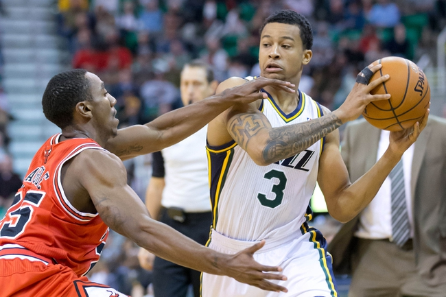 Nov 25, 2013; Salt Lake City, UT, USA; Utah Jazz point guard Trey Burke (3) is defended by Chicago Bulls point guard Marquis Teague (25) during the second half at EnergySolutions Arena. The Jazz won 89-83 in overtime. Mandatory Credit: Russ Isabella-USA TODAY Sports