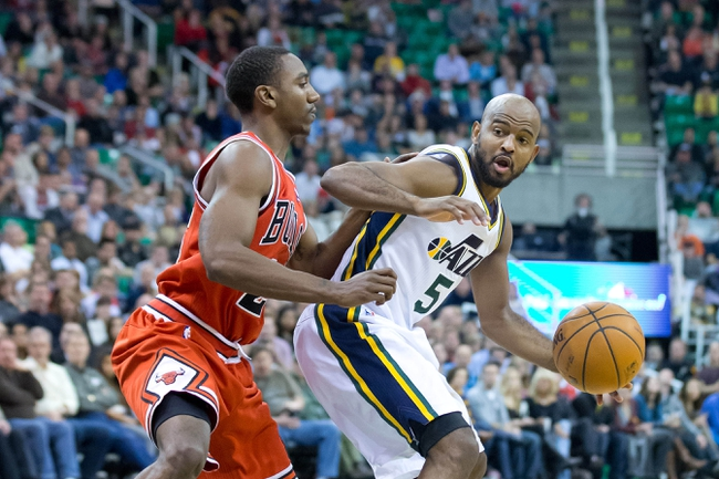 Nov 25, 2013; Salt Lake City, UT, USA; Utah Jazz point guard John Lucas III (5) is defended by Chicago Bulls point guard Marquis Teague (25) during the second half at EnergySolutions Arena. The Jazz won 89-83 in overtime. Mandatory Credit: Russ Isabella-USA TODAY Sports