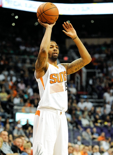 Nov 8, 2013; Phoenix, AZ, USA; Phoenix Suns power forward Marcus Morris (15) passes the ball during the fourth quarter against the Denver Nuggets at US Airways Center. Mandatory Credit: Casey Sapio-USA TODAY Sports