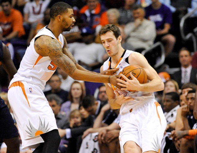 Nov 10, 2013; Phoenix, AZ, USA; Phoenix Suns power forward Marcus Morris (15) passes the ball to point guard Goran Dragic (1) during the third quarter against the New Orleans Pelicans at US Airways Center. The Suns beat the Pelicans 101-94. Mandatory Credit: Casey Sapio-USA TODAY Sports