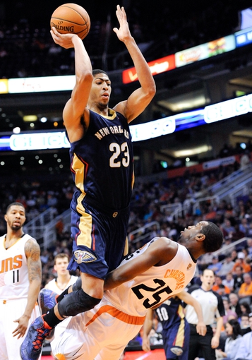 Nov 10, 2013; Phoenix, AZ, USA; New Orleans Pelicans power forward Anthony Davis (23) shoots the ball as he is defended by Phoenix Suns shooting guard Dionte Christmas (25) during the third quarter at US Airways Center. The Suns beat the Pelicans 101-94. Mandatory Credit: Casey Sapio-USA TODAY Sports