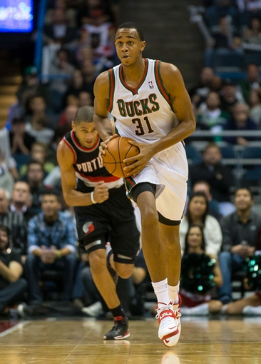 Nov 20, 2013; Milwaukee, WI, USA; Milwaukee Bucks forward John Henson (31) during the game against the Portland Trail Blazers at BMO Harris Bradley Center.  Portland won 91-82.  Mandatory Credit: Jeff Hanisch-USA TODAY Sports