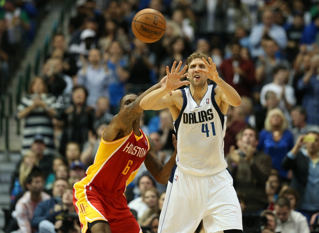Nov 20, 2013; Dallas, TX, USA; Houston Rockets forward Terrence Jones (6) defends against Dallas Mavericks forward Dirk Nowitzki (41) as he receives a pass int he post during the g second quarter at American Airlines Center. Mandatory Credit: Matthew Emmons-USA TODAY Sports