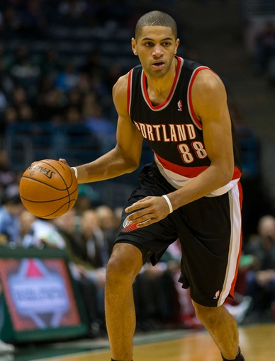 Nov 20, 2013; Milwaukee, WI, USA; Portland Trail Blazers forward Nicolas Batum (88) during the game against the Milwaukee Bucks at BMO Harris Bradley Center.  Portland won 91-82.  Mandatory Credit: Jeff Hanisch-USA TODAY Sports