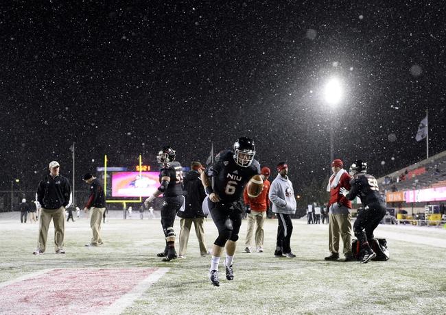 Nov 26, 2013; DeKalb, IL, USA; Northern Illinois Huskies quarterback Jordan Lynch (6) practices before the game against the Western Michigan Broncos at Huskie Stadium. Mandatory Credit: Mike DiNovo-USA TODAY Sports