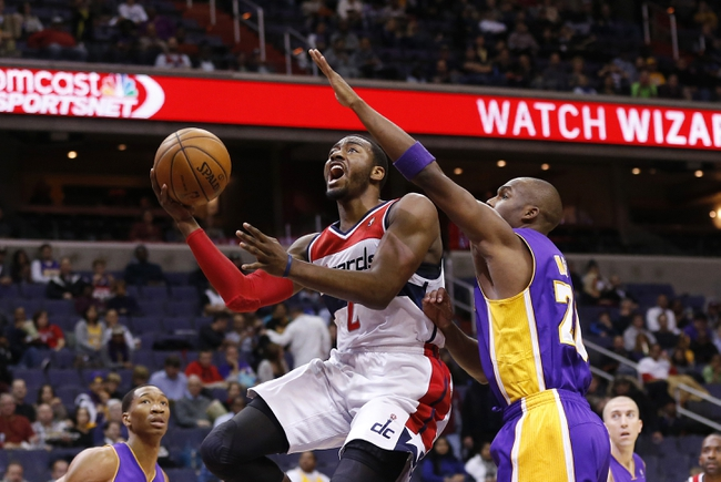 Nov 26, 2013; Washington, DC, USA; Washington Wizards point guard John Wall (2) shoots the ball as Los Angeles Lakers shooting guard Jodie Meeks (20) defends in the first quarter at Verizon Center. Mandatory Credit: Geoff Burke-USA TODAY Sports