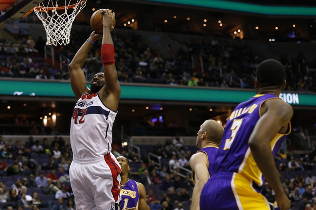 Nov 26, 2013; Washington, DC, USA; Washington Wizards power forward Nene Hilario (42) dunks the ball as Los Angeles Lakers point guard Steve Blake (5) watches in the first quarter at Verizon Center. Mandatory Credit: Geoff Burke-USA TODAY Sports