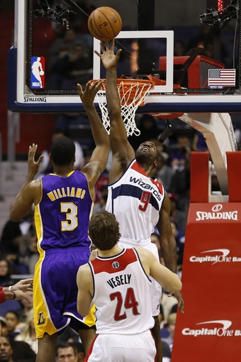 Nov 26, 2013; Washington, DC, USA; Washington Wizards small forward Martell Webster (9) blocks the shot of Los Angeles Lakers power forward Shawne Williams (3) in the first quarter at Verizon Center. Mandatory Credit: Geoff Burke-USA TODAY Sports
