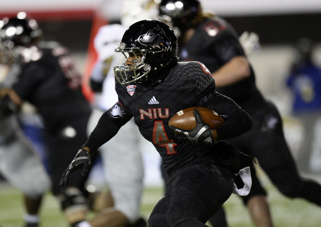 Nov 26, 2013; DeKalb, IL, USA; Northern Illinois Huskies wide receiver Da'Ron Brown (4) rushes the ball against the Western Michigan Broncos during the second quarter at Huskie Stadium. Mandatory Credit: Mike DiNovo-USA TODAY Sports