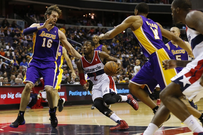 Nov 26, 2013; Washington, DC, USA; Washington Wizards point guard John Wall (2) dribbles the ball around Los Angeles Lakers center Pau Gasol (16) in the second quarter at Verizon Center. The Wizards won 116-111. Mandatory Credit: Geoff Burke-USA TODAY Sports
