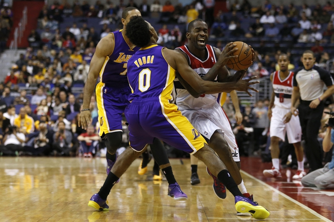 Nov 26, 2013; Washington, DC, USA; Washington Wizards small forward Martell Webster (9) holds the ball as Los Angeles Lakers small forward Nick Young (0) defends in the first quarter at Verizon Center. The Wizards won 116-111. Mandatory Credit: Geoff Burke-USA TODAY Sports