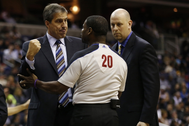 Nov 26, 2013; Washington, DC, USA; Washington Wizards head coach Randy Wittman demonstrates while arguing a call with referee Leroy Richardson (20) against the Los Angeles Lakers in the second quarter at Verizon Center. The Wizards won 116-111. Mandatory Credit: Geoff Burke-USA TODAY Sports