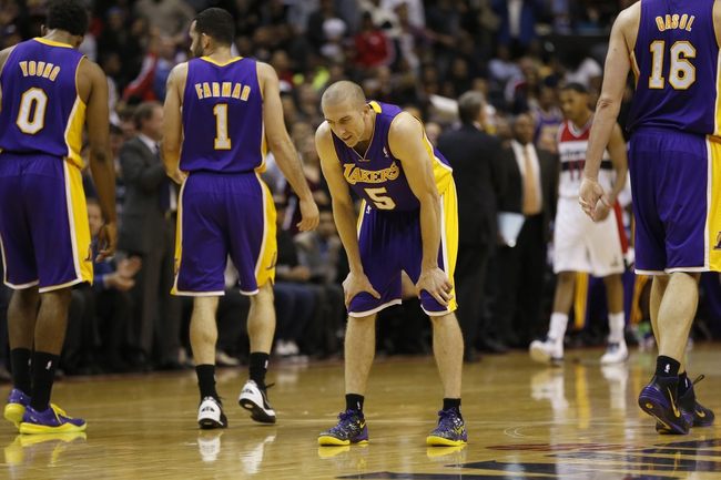 Nov 26, 2013; Washington, DC, USA; Los Angeles Lakers point guard Steve Blake (5) looks down after committing a turnover against the Washington Wizards in the fourth quarter at Verizon Center. The Wizards won 116-111. Mandatory Credit: Geoff Burke-USA TODAY Sports