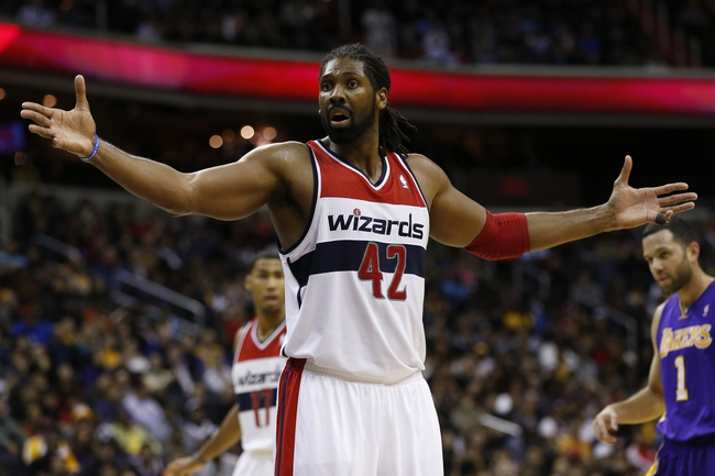 Nov 26, 2013; Washington, DC, USA; Washington Wizards power forward Nene Hilario (42) reacts against the Los Angeles Lakers in the fourth quarter at Verizon Center. The Wizards won 116-111. Mandatory Credit: Geoff Burke-USA TODAY Sports