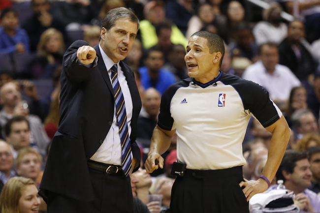 Nov 26, 2013; Washington, DC, USA; Washington Wizards head coach Randy Wittman argues with referee Scott Twardoski (76) against the Los Angeles Lakers in the fourth quarter at Verizon Center. The Wizards won 116-111. Mandatory Credit: Geoff Burke-USA TODAY Sports