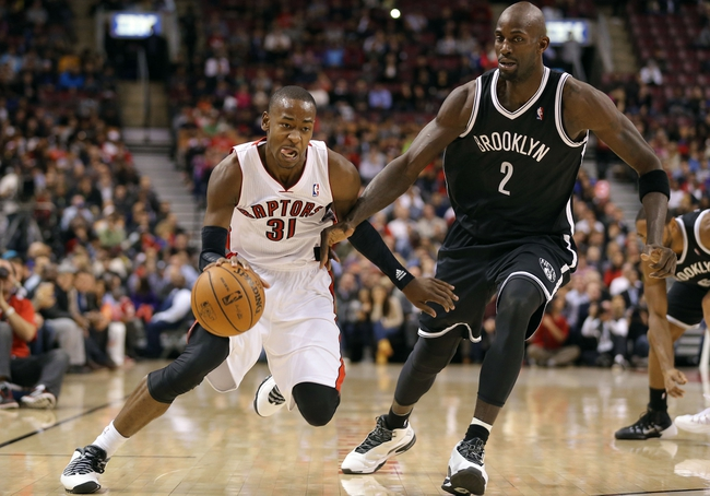 Nov 26, 2013; Toronto, Ontario, CAN; Toronto Raptors guard Terrence Ross (31) makes a move to the basket against Brooklyn Nets forward Kevin Garnett (2) at Air Canada Centre. The Nets beat the Raptors 102-100. Mandatory Credit: Tom Szczerbowski-USA TODAY Sports