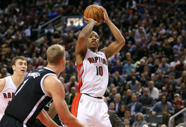 Nov 26, 2013; Toronto, Ontario, CAN; Toronto Raptors guard DeMar DeRozan (10) shoots against the Brooklyn Nets at Air Canada Centre. The Nets beat the Raptors 102-100. Mandatory Credit: Tom Szczerbowski-USA TODAY Sports