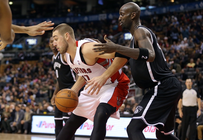 Nov 26, 2013; Toronto, Ontario, CAN; Toronto Raptors center Jonas Valanciunas (17) is guarded by Brooklyn Nets forward Kevin Garnett (2) at Air Canada Centre. The Nets beat the Raptors 102-100. Mandatory Credit: Tom Szczerbowski-USA TODAY Sports