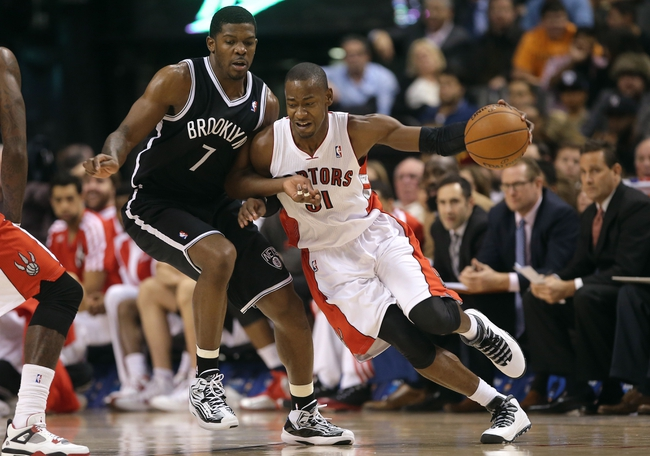 Nov 26, 2013; Toronto, Ontario, CAN; Toronto Raptors guard Terrence Ross (31) tries to get past Brooklyn Nets guard Joe Johnson (7) at Air Canada Centre. The Nets beat the Raptors 102-100. Mandatory Credit: Tom Szczerbowski-USA TODAY Sports
