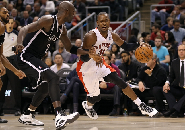 Nov 26, 2013; Toronto, Ontario, CAN; Toronto Raptors guard Terrence Ross (31) tries to get past Brooklyn Nets forward Kevin Garnett (2) at Air Canada Centre. The Nets beat the Raptors 102-100. Mandatory Credit: Tom Szczerbowski-USA TODAY Sports