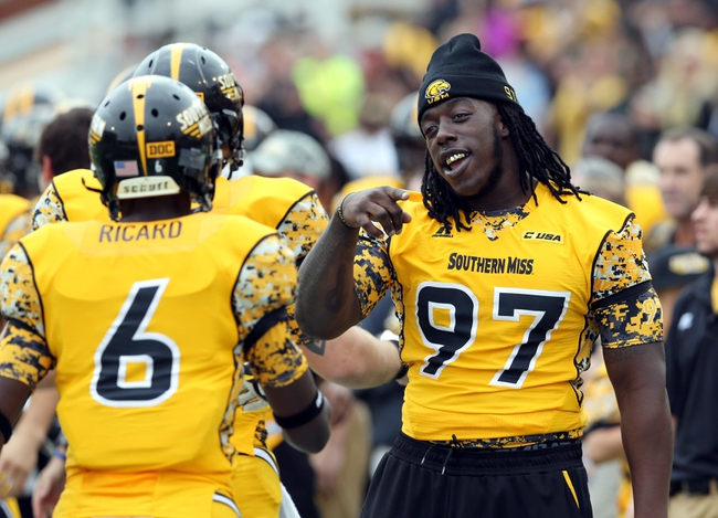 Nov 16, 2013; Hattiesburg, MS, USA; Southern Mississippi Golden Eagles defensive lineman Rakeem Nunez-Roches (97) talks to teammates during the second half of their game against the Florida Atlantic Owls at M.M. Roberts Stadium. Florida Atlantic won, 41-7. Mandatory Credit: Chuck Cook-USA TODAY Sports