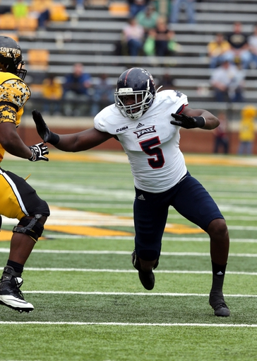 Nov 16, 2013; Hattiesburg, MS, USA; Florida Atlantic Owls defensive end Martin Wright (5) during the second half of their game against the Southern Mississippi Golden Eagles at M.M. Roberts Stadium. Florida Atlantic won, 41-7. Mandatory Credit: Chuck Cook-USA TODAY Sports