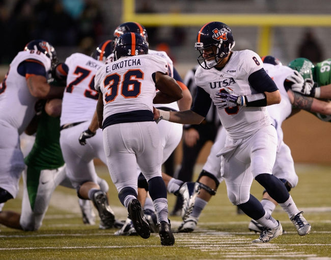 Nov 23, 2013; Denton, TX, USA; UTSA Roadrunners quarterback Eric Soza (8) hands off to running back Evans Okotcha (36) during the game against the UTSA Roadrunners at Apogee Stadium. The Roadrunners defeated the Mean Green 21-13. Mandatory Credit: Jerome Miron-USA TODAY Sports