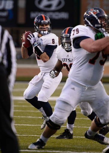 Nov 23, 2013; Denton, TX, USA; UTSA Roadrunners quarterback Eric Soza (8) drops back to pass against the North Texas Mean Green during the game at Apogee Stadium. The Roadrunners defeated the Mean Green 21-13. Mandatory Credit: Jerome Miron-USA TODAY Sports