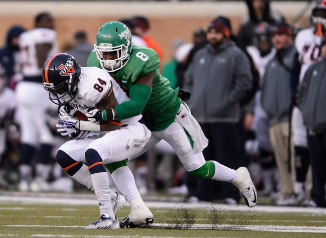 Nov 23, 2013; Denton, TX, USA; North Texas Mean Green defensive back Marcus Trice (8) tackles UTSA Roadrunners wide receiver Brandon Freeman (84) during the game at Apogee Stadium. The Roadrunners defeated the Mean Green 21-13. Mandatory Credit: Jerome Miron-USA TODAY Sports