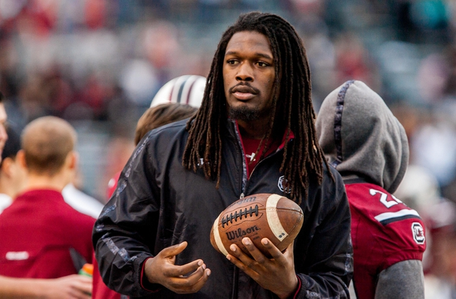 Nov 23, 2013; Columbia, SC, USA; South Carolina Gamecocks defensive end Jadeveon Clowney (7) sits out the game against the Coastal Carolina Chanticleers with an injury during the second half at Williams-Brice Stadium. Mandatory Credit: Jeff Blake-USA TODAY