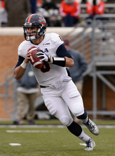 Nov 23, 2013; Denton, TX, USA; UTSA Roadrunners quarterback Eric Soza (8) rolls out during the game against the North Texas Mean Green at Apogee Stadium. The Roadrunners defeated the Mean Green 21-13. Mandatory Credit: Jerome Miron-USA TODAY Sports