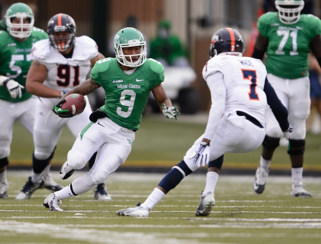 Nov 23, 2013; Denton, TX, USA; North Texas Mean Green wide receiver Carlos Harris (9) runs for a first down against the UTSA Roadrunners during the game at Apogee Stadium. The Roadrunners defeated the Mean Green 21-13. Mandatory Credit: Jerome Miron-USA TODAY Sports