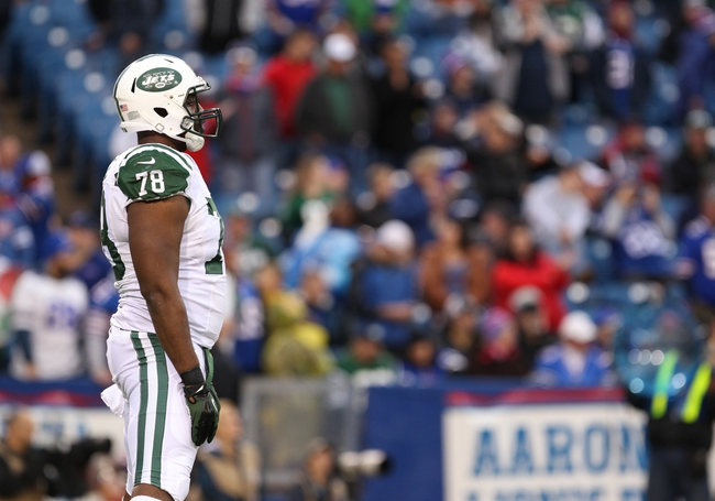 Nov 17, 2013; Orchard Park, NY, USA; New York Jets defensive tackle Leger Douzable (78) during a game against the Buffalo Bills at Ralph Wilson Stadium. Bills beat the Jets 37 to 14.  Mandatory Credit: Timothy T. Ludwig-USA TODAY Sports