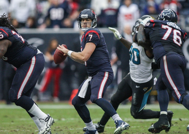 Nov 24, 2013; Houston, TX, USA; Jacksonville Jaguars quarterback Chad Henne (7) looks for an open receiver during the fourth quarter against the Jacksonville Jaguars at Reliant Stadium. Mandatory Credit: Troy Taormina-USA TODAY Sports