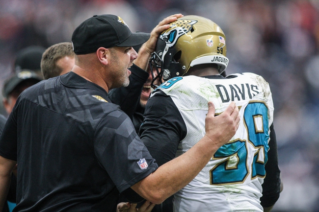 Nov 24, 2013; Houston, TX, USA; Jacksonville Jaguars defensive end Ryan Davis (59) is congratulated after making an interception during the fourth quarter against the Houston Texans at Reliant Stadium. Mandatory Credit: Troy Taormina-USA TODAY Sports