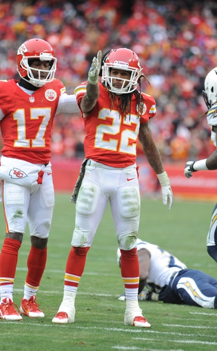 Nov 24, 2013; Kansas City, MO, USA; Kansas City Chiefs running back Jamaal Charles (25) does the tomahawk chop to the crowd during the second half of the game against the San Diego Chargers at Arrowhead Stadium. The Chargers won 41-38. Mandatory Credit: Denny Medley-USA TODAY Sports