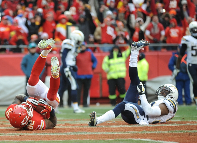 Nov 24, 2013; Kansas City, MO, USA; Kansas City Chiefs wide receiver Dwayne Bowe (82) scores a touchdown against San Diego Chargers strong safety Marcus Gilchrist (38) during the second half of the game at Arrowhead Stadium. The Chargers won 41-38. Mandatory Credit: Denny Medley-USA TODAY Sports