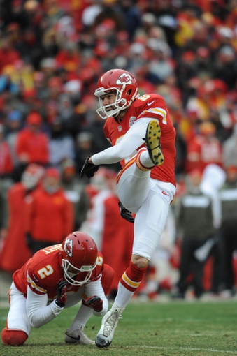 Nov 24, 2013; Kansas City, MO, USA; Kansas City Chiefs kicker Ryan Succop (6) kicks a point after with punter Dustin Colquitt (2) holding during the second half of the game against the San Diego Chargers at Arrowhead Stadium. The Chargers won 41-38. Mandatory Credit: Denny Medley-USA TODAY Sports