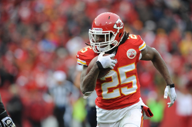 Nov 24, 2013; Kansas City, MO, USA; Kansas City Chiefs running back Jamaal Charles (25) runs the ball during the second half of the game against the San Diego Chargers at Arrowhead Stadium. The Chargers won 41-38. Mandatory Credit: Denny Medley-USA TODAY Sports